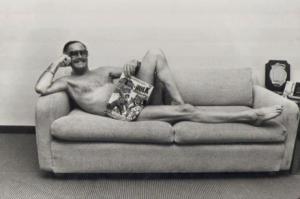 Stan-Lee-posing-with-the-Batman-vs.-The-Incredible-Hulk-comic-book-1983