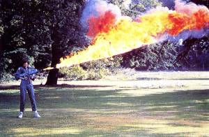 Sigourney-Weaver-testing-the-flamethrower-for-Alien-on-the-lawn-at-Shepperton-Studios
